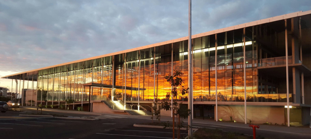 KDV Golf and Tennis Academy, earlier image of front elevation looking slightly east at sunrise, taken on a builder's phone camera.